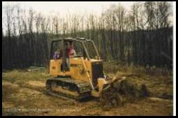 Ron works a Case 650 dozer on his property near Martinsville
